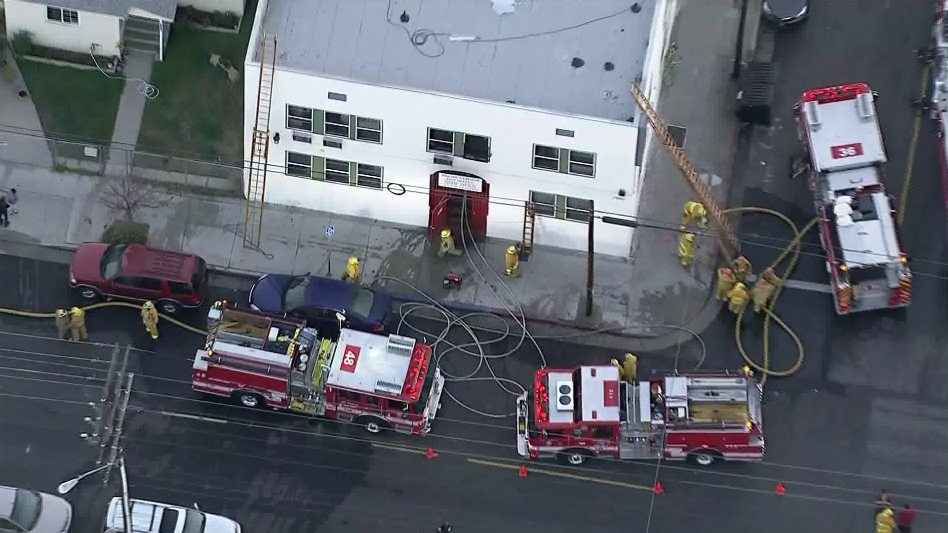 Fire crews investigate the scene where a blaze broke out at an apartment complex in San Pedro on April 26, 2018. (Credit: KTLA)