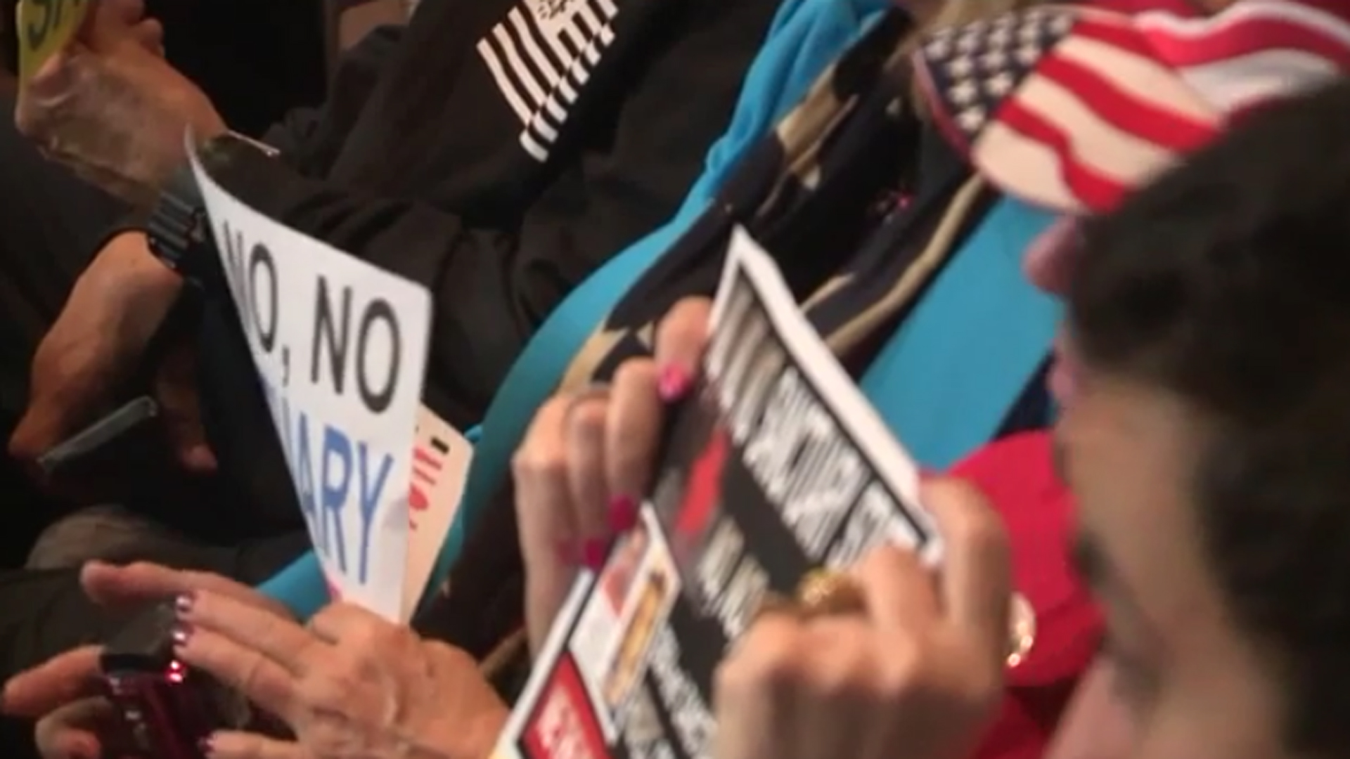 Protesters oppose sanctuary state at an Orange County Board of Supervisors meeting in this undated photo. (Credit: KSWB)