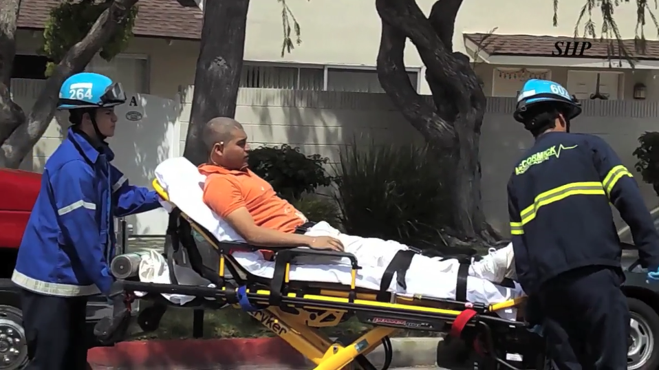 A man is transported to the hospital after being injured in a explosion at a Torrance apartment complex on April 8, 2018. (Credit: Street Heat)