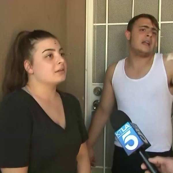 Christina and Harry Nalbandyan, from left, are seen outside their home in Panorama City on April 25, 2018. (Credit: KTLA)