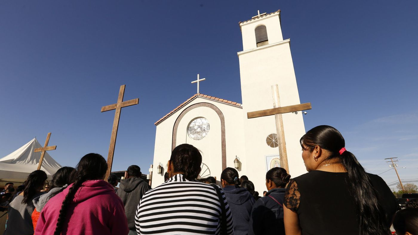 Family and friends attend funeral services on April 2 at Our Lady of Guadalupe Church in Delano for migrant farmworkers, whose vehicle crashed as they fled immigration agents. (Credit: Al Seib / Los Angeles Times)