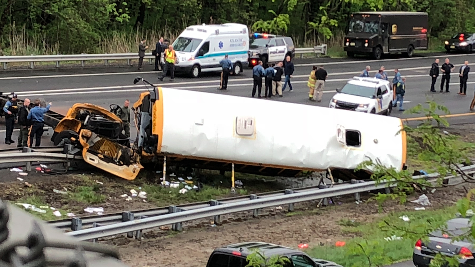 A bus overturned after a crash involving a dump truck in New Jersey on May 17, 2018. (Credit: Henry Rosoff / WPIX)