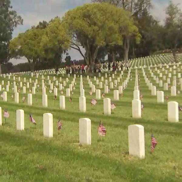 American flags line the graves of fallen service members at Los Angeles National Cemetery on May 26, 2018. (Credit: KTLA)