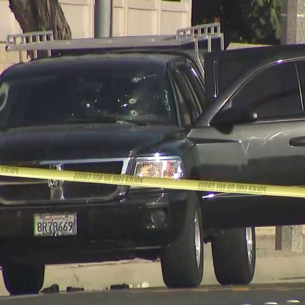 Bullet holes from police gunfire are seen in the windshield of a pickup whose driver allegedly tried to run over two Fountain Valley officers on Oct. 14, 2017. (Credit: OC Hawk)