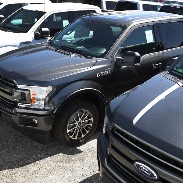 Ford F-150 pickup trucks are seen on a Miami, Florida, sales lot on Oct. 26, 2017. (Credit: Joe Raedle / Getty Images)