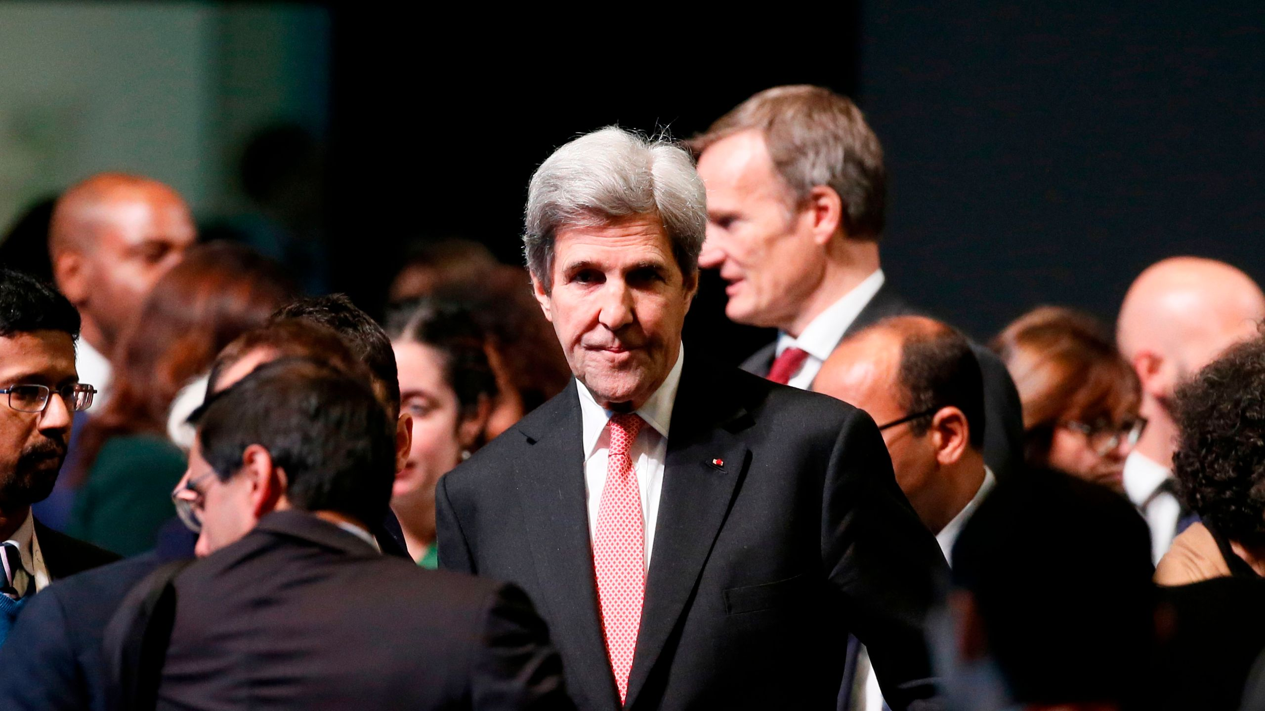 Former U.S. Secretary of State John Kerry arrives to attend the One Planet Summit on Dec. 12, 2017, at La Seine Musicale venue on the ile Seguin in Boulogne-Billancourt, southwest of Paris. (Credit: ETIENNE LAURENT/AFP/Getty Images)
