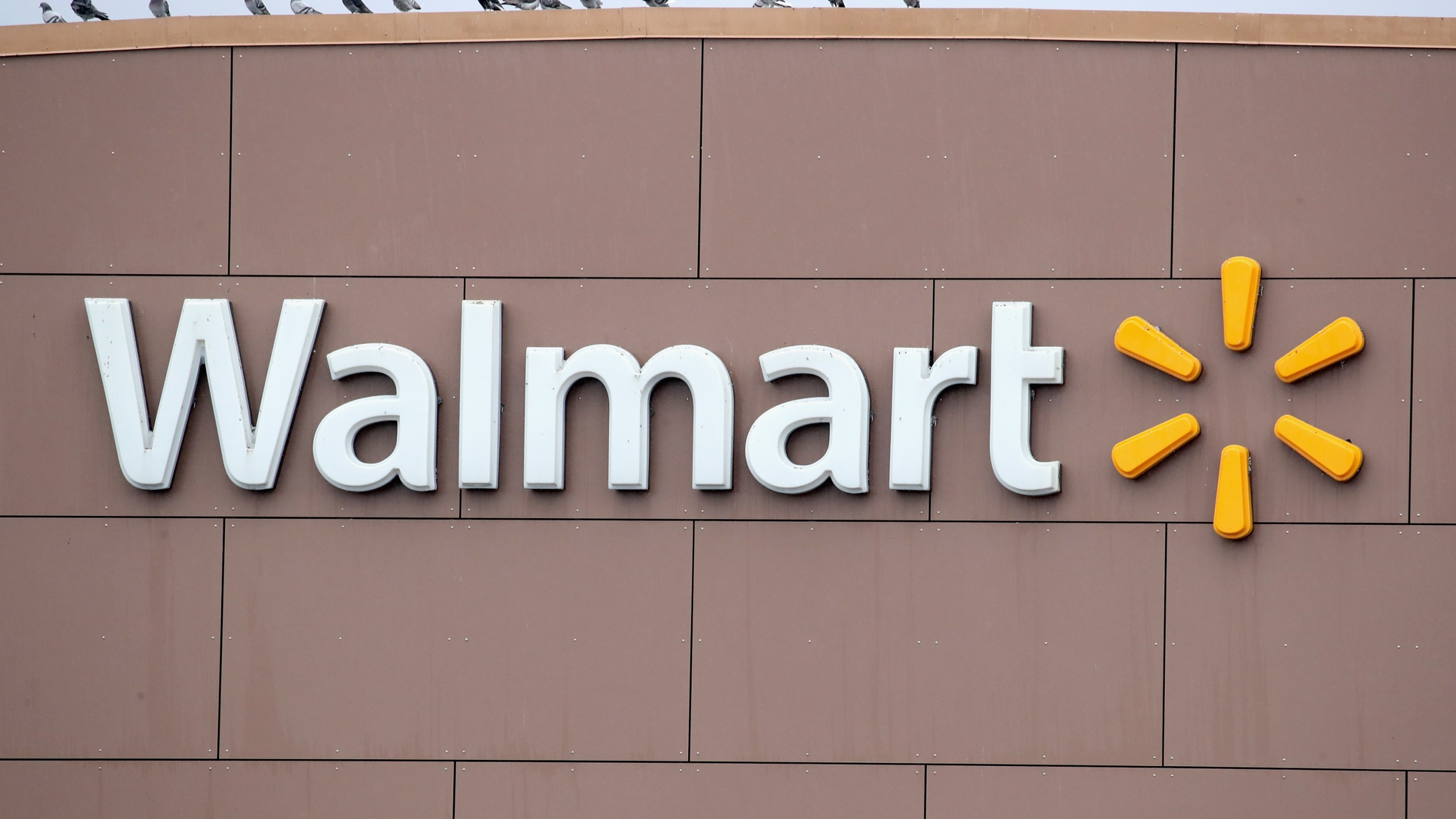 A sign hangs outside Walmart store on January 11, 2018, in Chicago, Illinois. (Credit: Scott Olson/Getty Images)