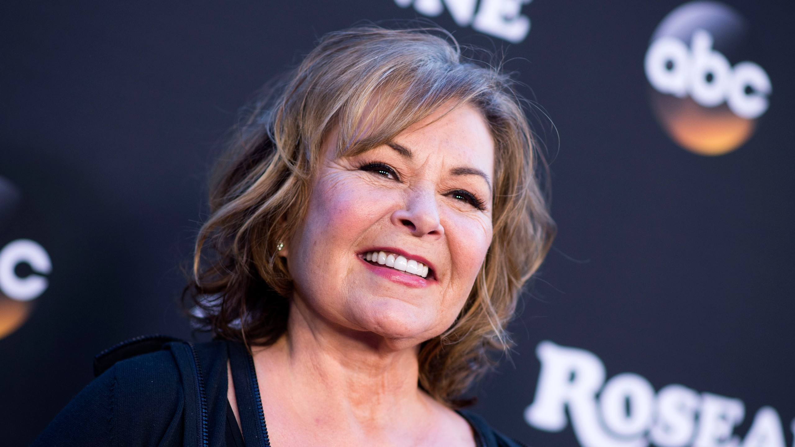 "Roseanne Barr attends the ""Roseanne"" series premiere at Walt Disney Studios on March 23, 2018 in Burbank. (Credit: VALERIE MACON/AFP/Getty Images)"