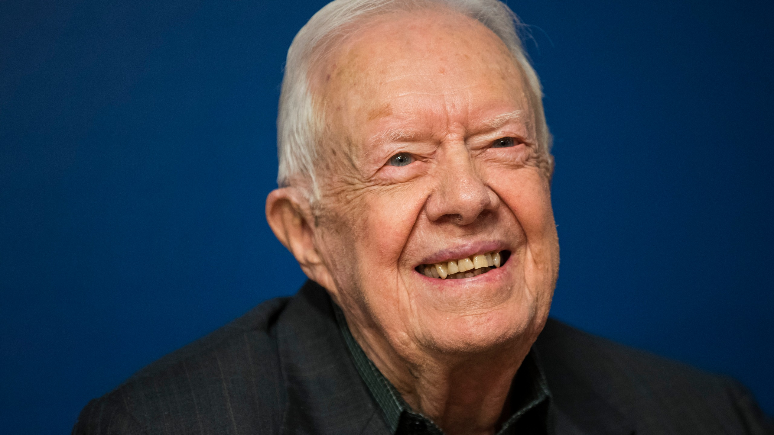"""Former U.S. President Jimmy Carter smiles during a book signing event for his new book """"Faith: A Journey For All"""" at Barnes & Noble bookstore in Midtown Manhattan, March 26, 2018, in New York City. (Credit: Drew Angerer/Getty Images)"""