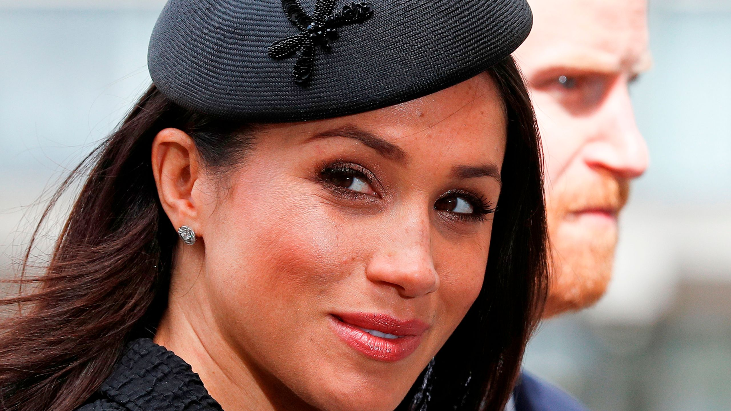 Meghan Markle arrives with her fiance Prince Harry to attend a service of commemoration on Anzac Day in Westminster Abbey in London on April 25, 2018. (Credit: Adrian Dennis / AFP / Getty Images)