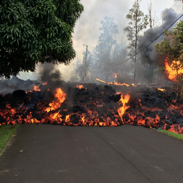 In this handout photo provided by the U.S. Geological Survey, a lava flow moves on Makamae Street after the eruption of Hawaii's Kilauea volcano on May 6, 2018 in the Leilani Estates subdivision near Pahoa, Hawaii. (Credit: U.S. Geological Survey via Getty Images)