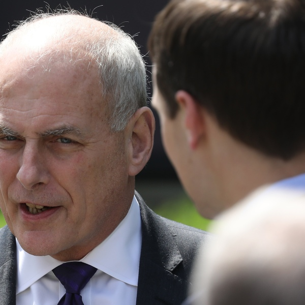 White House Chief of Staff John Kelly, left, speaks with senior White House adviser Jared Kushner at an event where Melania Trump spoke in the Rose Garden of the White House, May 7, 2018. (Credit: Win McNamee / Getty Images)