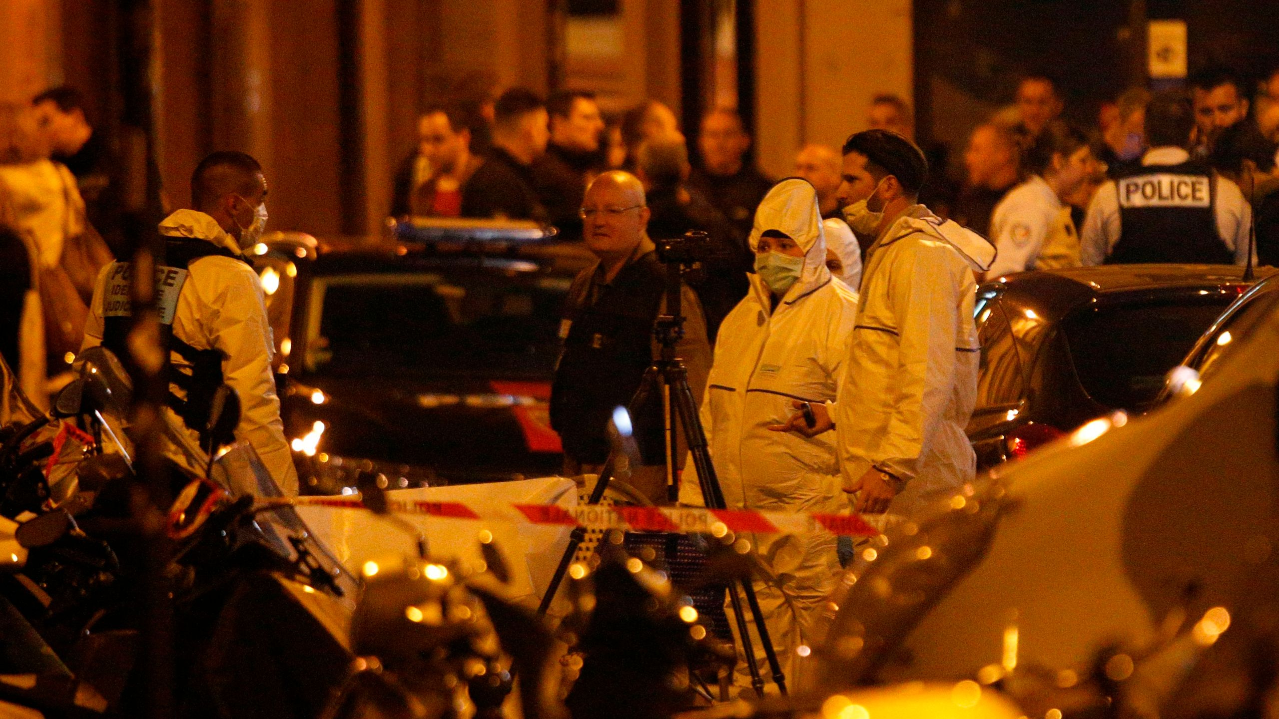 Forensic officers and French policemen stand in Monsigny street in Paris centre on May 12, 2018. (Credit: GEOFFROY VAN DER HASSELT/AFP/Getty Images)