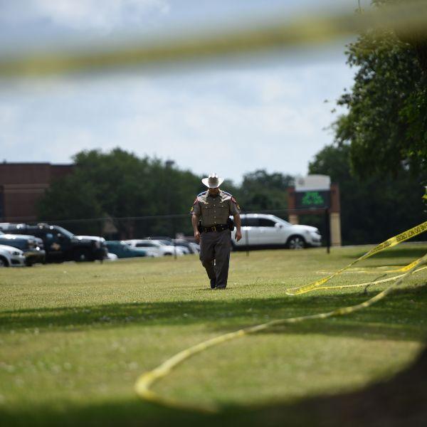 Police officers patrol outside Santa Fe High School on May 19, 2018, in Santa Fe, Texas. (Credit: BRENDAN SMIALOWSKI/AFP/Getty Images)