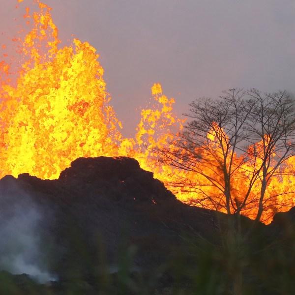 Lava from a Kilauea volcano fissure erupts on Hawaii's Big Island on May 20, 2018 in Kapoho, Hawaii. (Credit: Mario Tama/Getty Images)