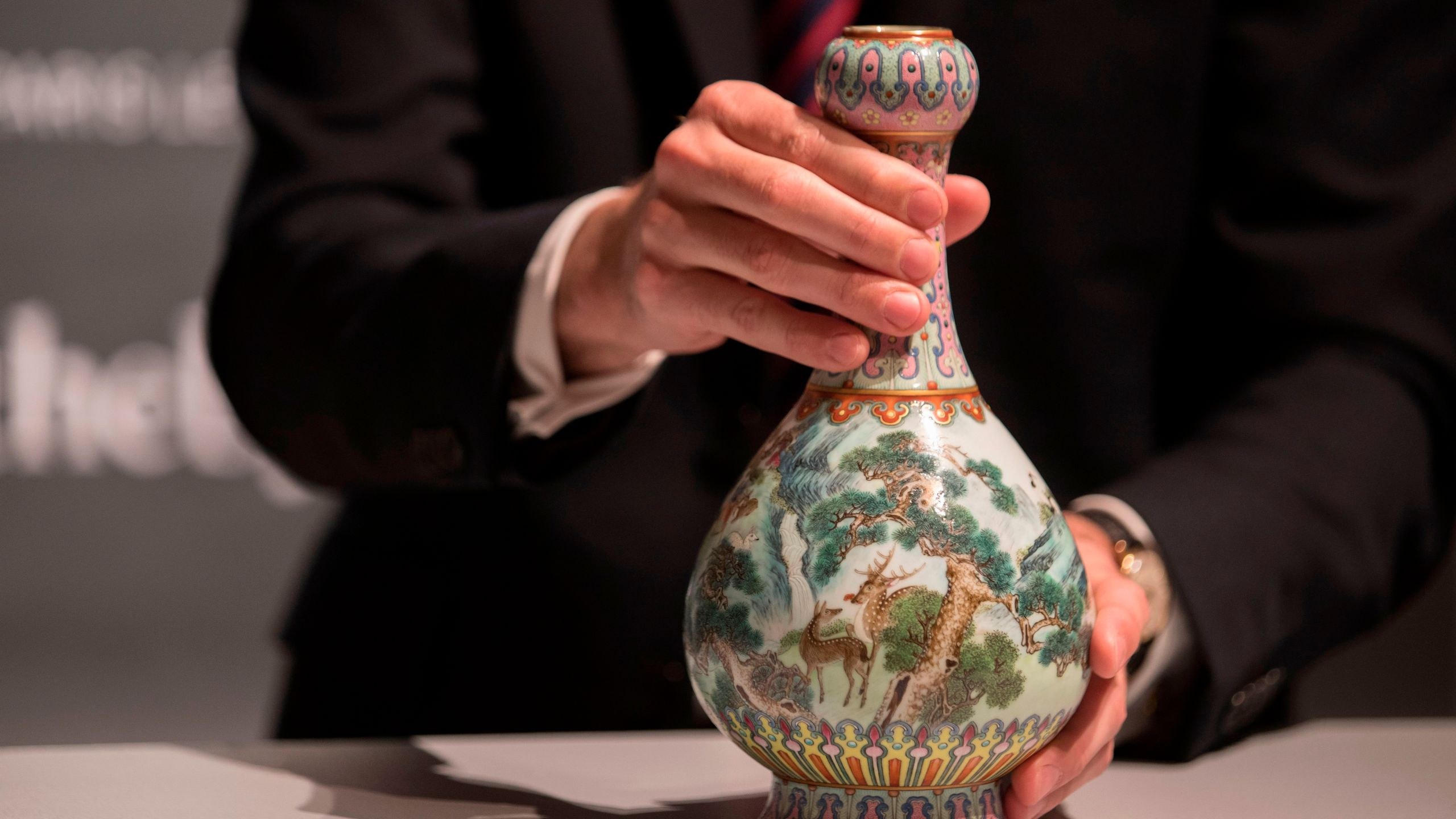 A rare Imperial Qianlong porcelain vase is displayed at Sotheby's auction company in Paris, on May 22, 2018. The vase, which was stored in a shoebox in an attic for decades, will be sold at Sotheby's Paris on June. (Credit: THOMAS SAMSON/AFP/Getty Images)