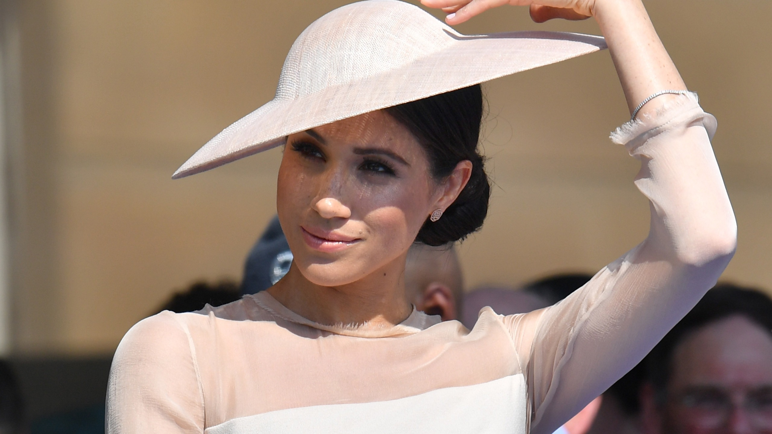 Meghan, Duchess of Sussex, attends The Prince of Wales' 70th birthday celebration at Buckingham Palace on May 22, 2018. (Credit: Dominic Lipinski / Getty Images)