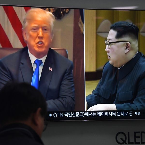 A man watches a television news showing North Korean leader Kim Jong Un and Donald Trump at a railway station in Seoul on May 24, 2018. (Credit: Jung Yeon-Je/AFP/Getty Images)