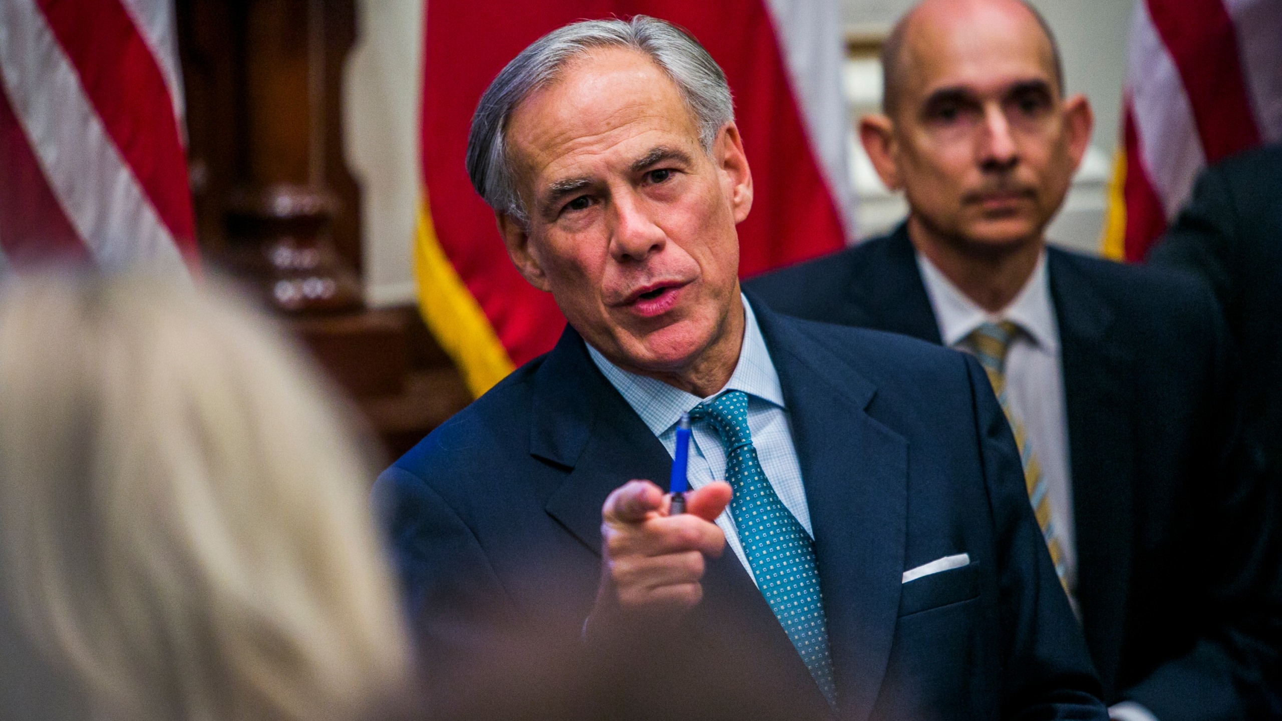 Texas Gov. Greg Abbott holds a roundtable discussion with victims, family, and friends affected by the Santa Fe, Texas school shooting at the state capital on May 24, 2018, in Austin, Texas. (Credit: Drew Anthony Smith/Getty Images)