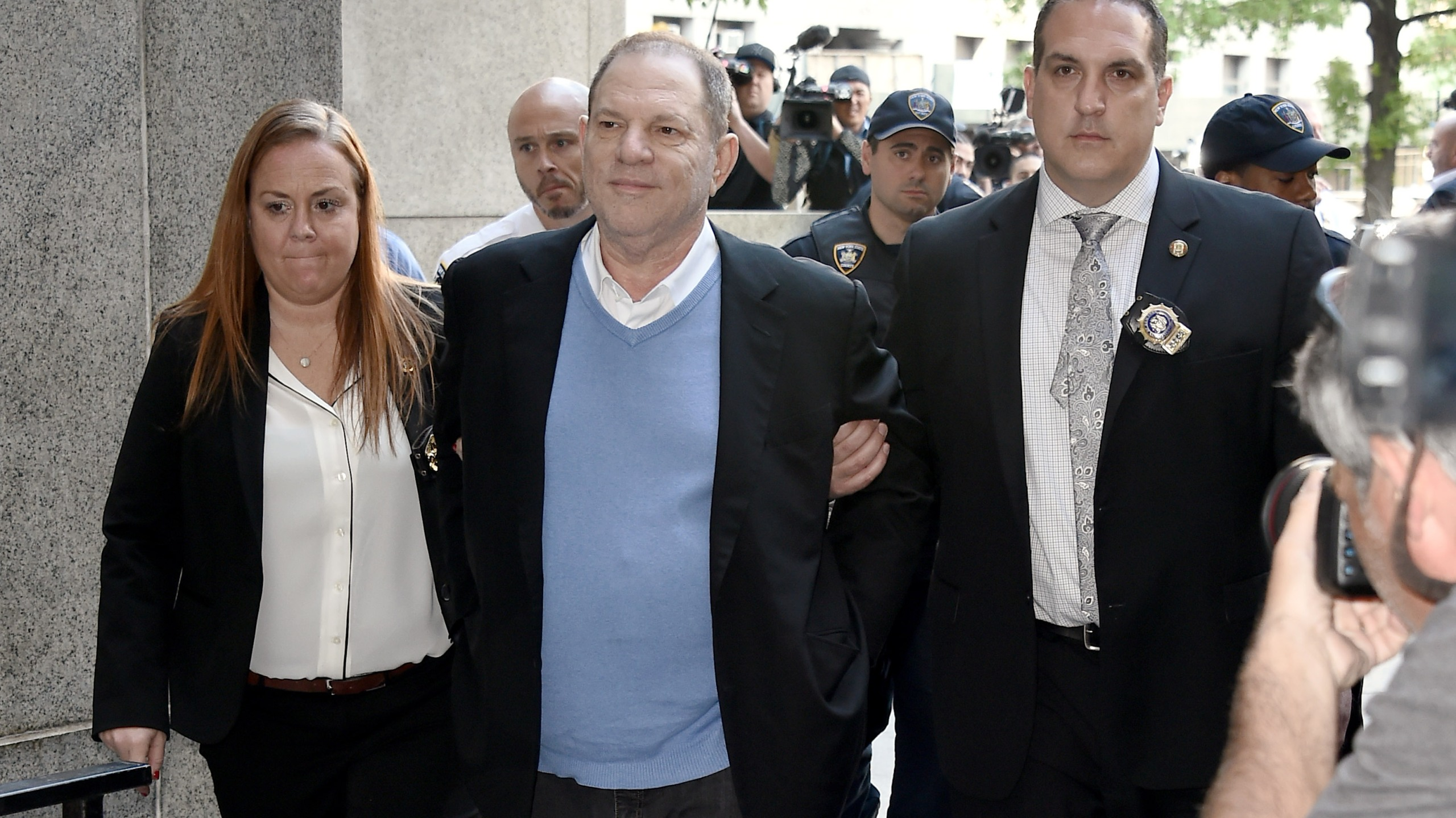 Harvey Weinstein arrives for arraignment at Manhattan Criminal Courthouse on May 25, 2018 after being arrested and processed on charges of rape, committing a criminal sex act, sexual abuse and sexual misconduct.(Credit: Steven Ferdman/Getty Images)