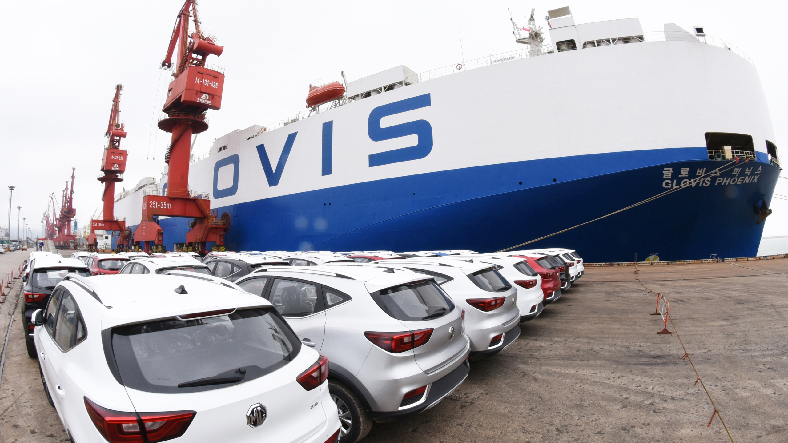 This photo taken on May 26, 2018 shows MG cars produced by Shanghai Automotive Industry Corporation waiting to be exported to the US at a port in Lianyungang in China's eastern Jiangsu province. Donald Trump's threat to impose steep tariffs on auto imports will hit foreign automakers that export a large number of vehicles to the US market, but many also manufacture cars domestically. (Credit: AFP/Getty Images)