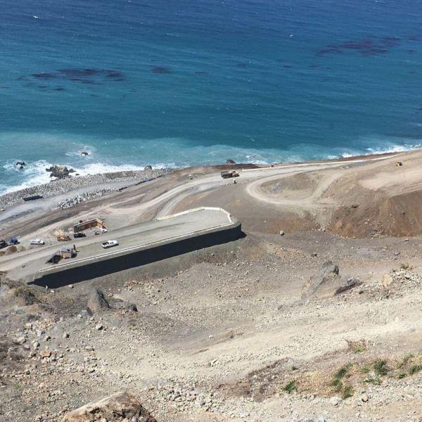 An aerial view of work being done on Highway 1 at Mud Creek. Last May, a major landslide wiped out this stretch of the iconic coastal route. (Credit: Caltrans)