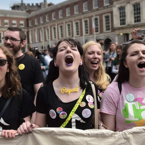"""""""Yes"""" vote supporters celebrate as the results in the Irish referendum on the 8th amendment concerning the country's abortion laws takes place at Dublin Castle on May 26, 2018, in Dublin, Ireland. (Credit: Charles McQuillan/Getty Images)"""
