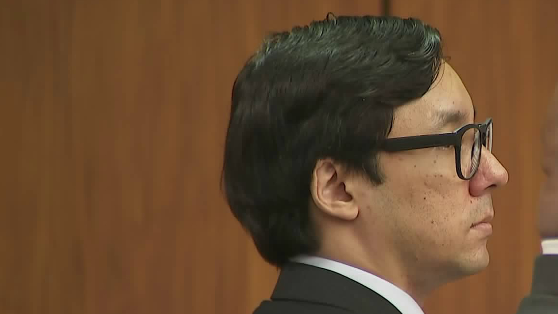 Kevon Ross, 33, listens to a judge speak just moments before being convicted on May 30, 2018, of murdering and raping a woman in Gardena and raping three others. (Credit: KTLA)