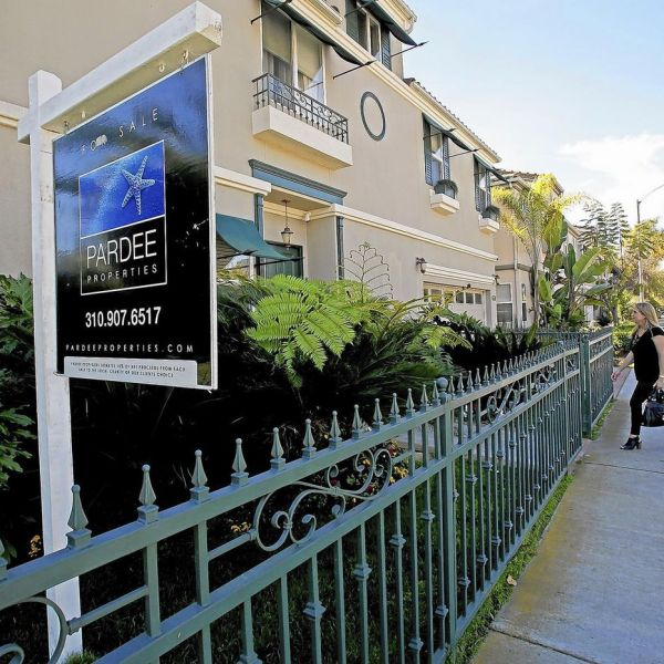An undated photo shows a for sale sign at a residential property in California. (Credit: Anne Cusack / Los Angeles Times)