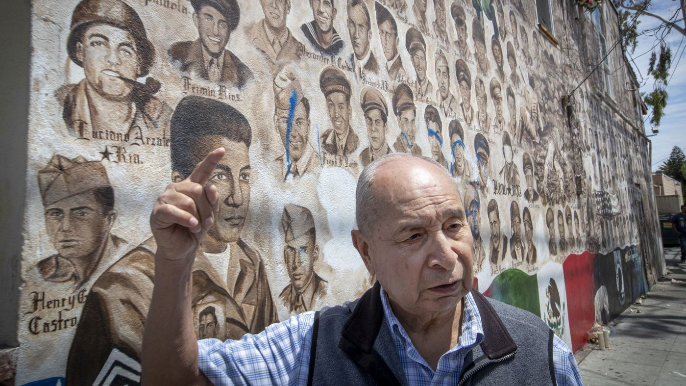 Samuel Romero, 83, a Logan neighborhood resident and veteran, speaks on May 29, 2018, about vandalism near his father's portrait on a Santa Ana veterans' memorial that depicts portraits of 200 Mexican American men and women who have served in wars dating to World War I. (Credit: Allen J. Schaben / Los Angeles Times)
