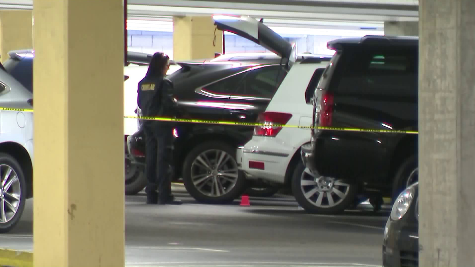 Investigators search for evidence in a Mercedes-Benz GLK parked in a Rolling Hills Estates mall garage after a woman was found stabbed to death inside the SUV on May 3, 2018. (Credit: KTLA)