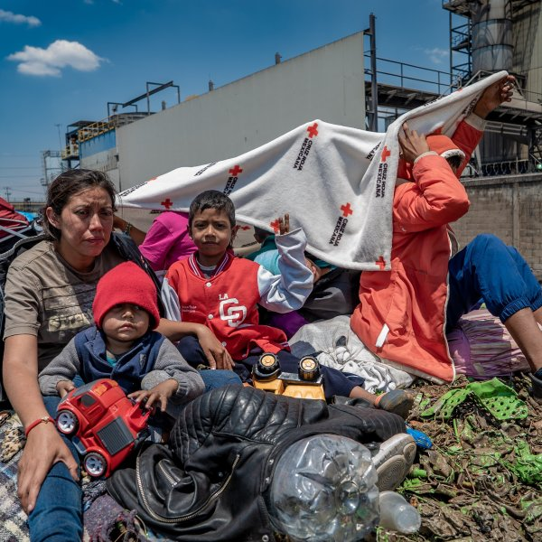 Gabriela Hernandez sits with her two sons on April 14, 2018, after traveling through Mexico to request asylum in the U.S. (Credit: CNN)