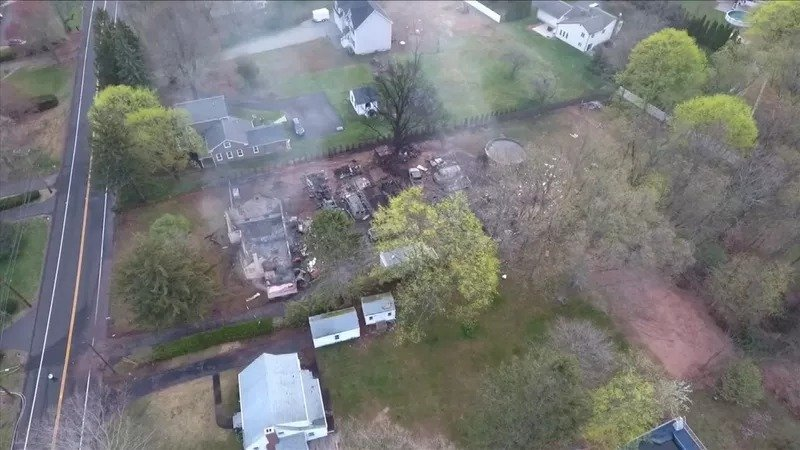 At least six police officers were injured in an explosion late Wednesday when they responded to a report about a man holding his wife hostage, a North Haven, Connecticut, city official said. (Credit: WFSB)