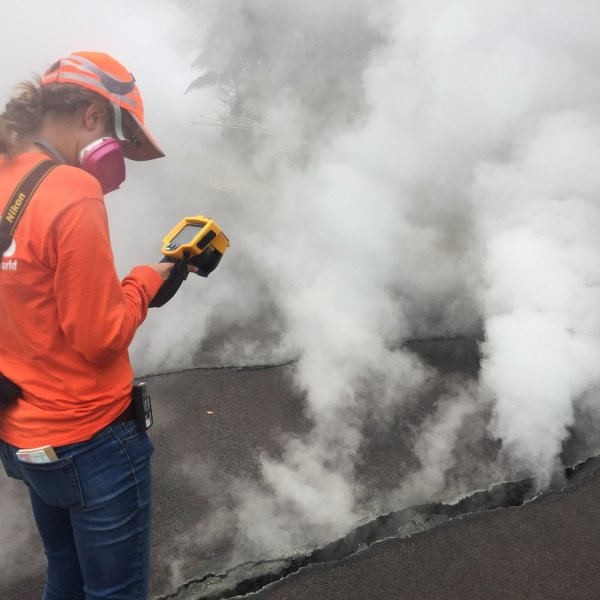 """USGS-Hawaiian Volcano Observatory geologist measured a temperature of 103 degrees C (218 degree F) at a crack along Nohea Street, Leilani Estates. The asphalt road was describes as """"mushy"""" from the heat. (Credit: USGS VOLCANOES)"""