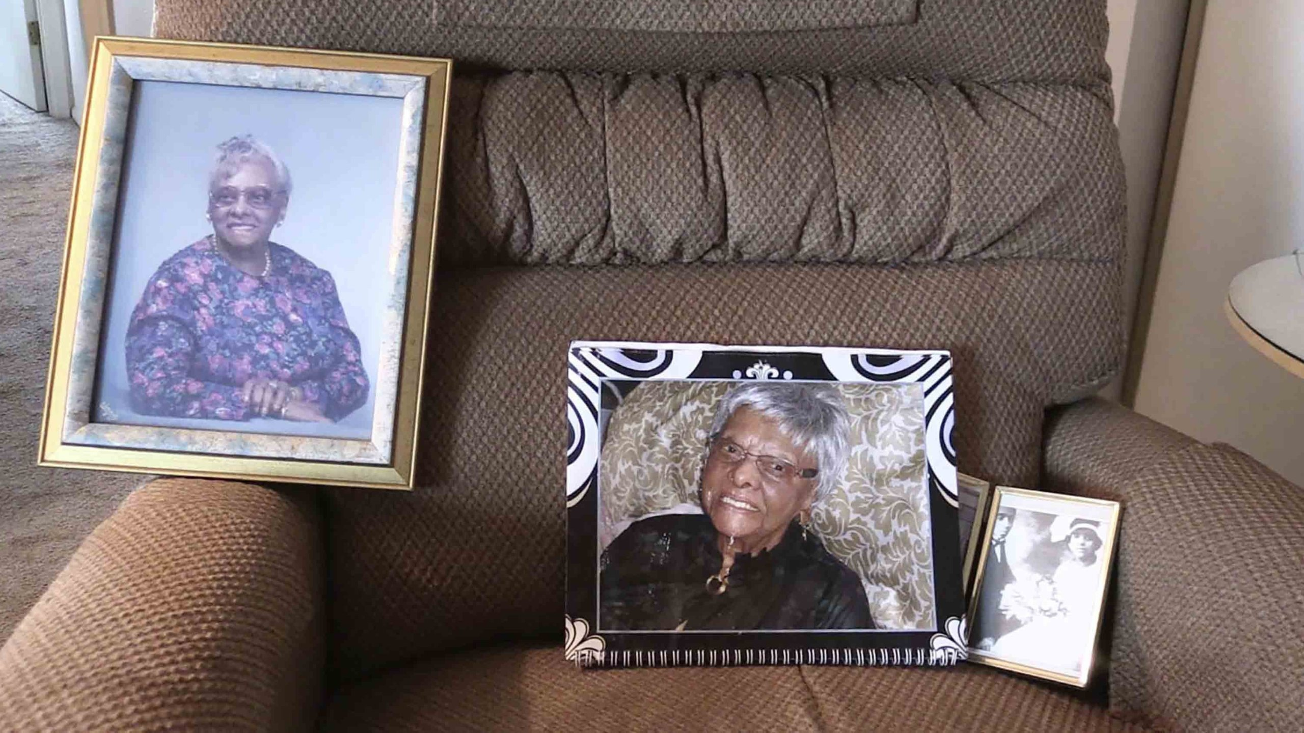 In this May 11, 2018 frame from video, photos of Lessie Brown rest on a chair in Cleveland Heights, Ohio. (Credit: David Petkiewicz / AP via CNN)