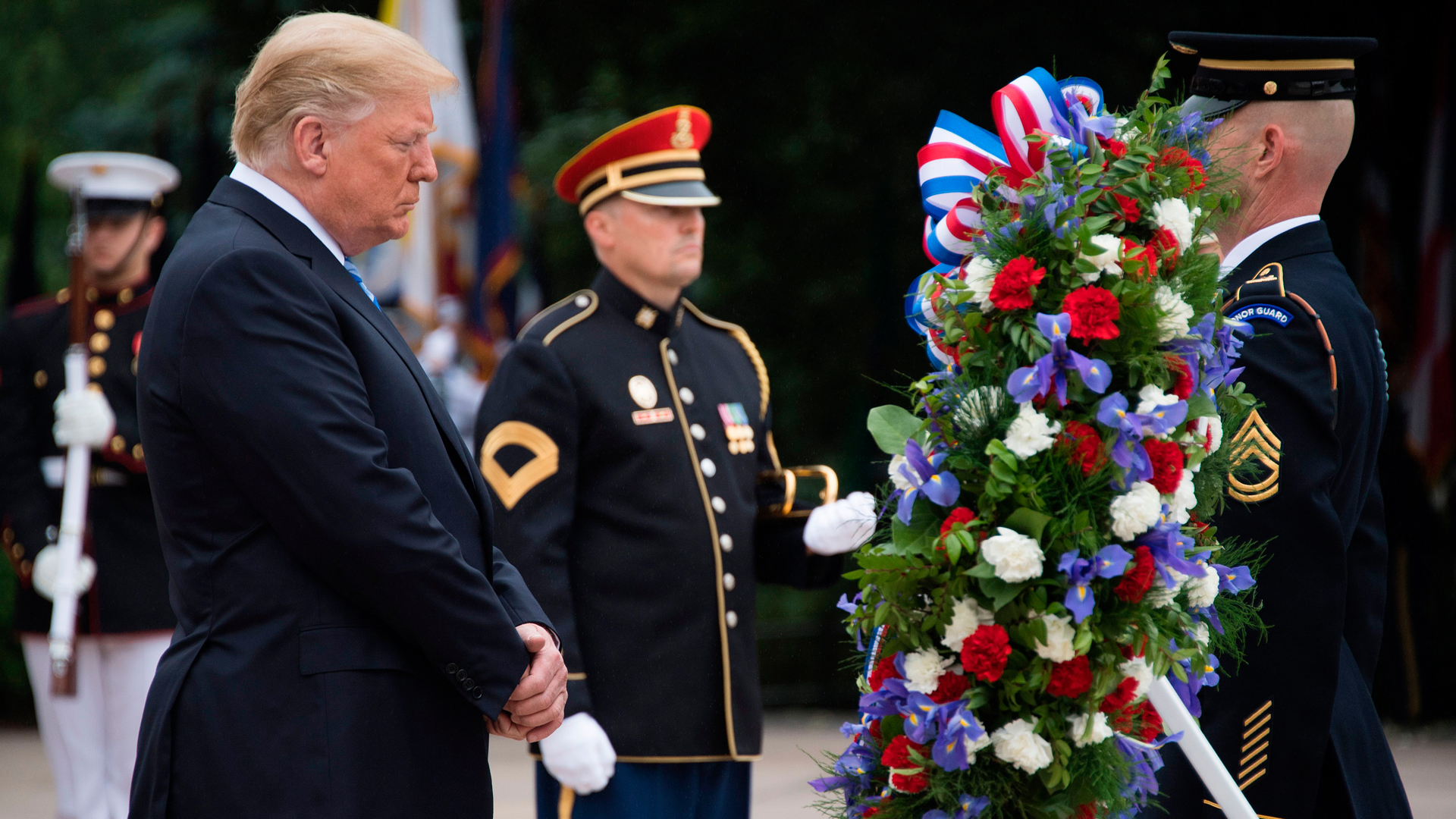 President Donald Trump marks Memorial Day by laying a wreath at the Tomb of the Unknown Soldier at Arlington National Cemetery in Arlington, Virginia, on May 28, 2018 (Credit: Jim Watson/AFP/Getty Images)
