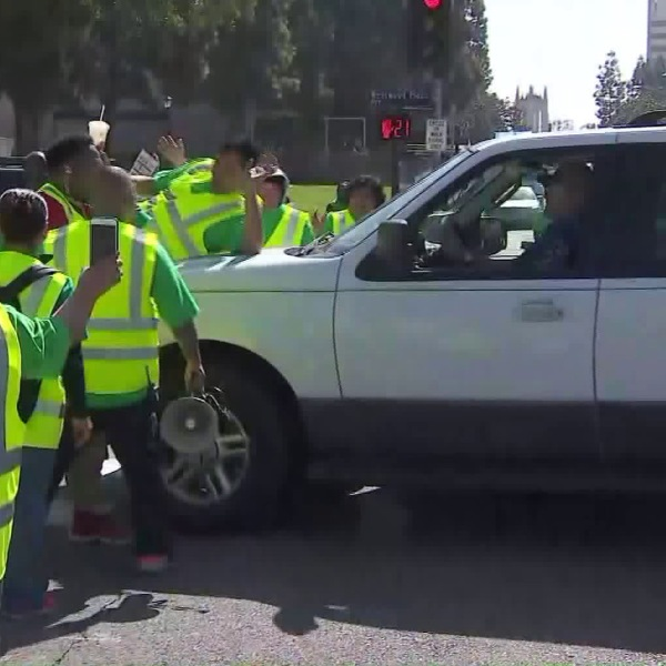 A man drives his vehicle into the crowd as UCLA staff members took part of a statewide strike by University of California service workers on May 7, 2018. (Credit: KTLA)