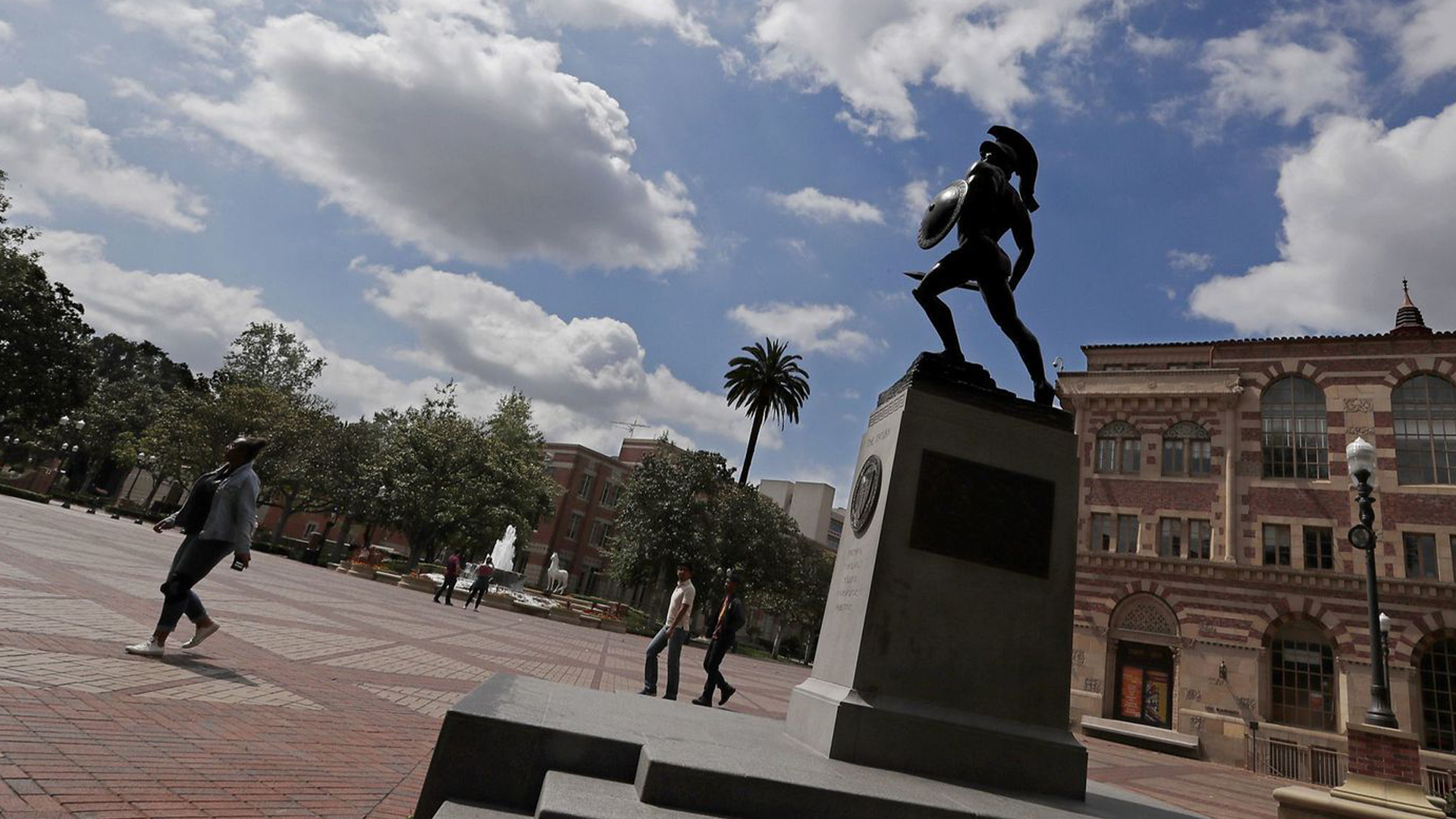 In a file photo, the statue of Tommy Trojan looks up at cloudy skies from his pedestal in the middle of the USC campus. (Credit: Luis Sinco / Los Angeles Times)