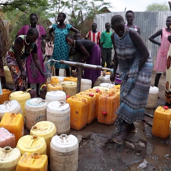 Plastic jugs are used to transport clean water to the Kakuma refugee camp in Kenya. (Credit: KTLA)