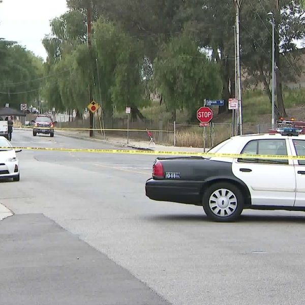 The scene in Woodland Hills where police discovered possible explosives inside a vehicle suspected to be stolen is seen here just hours later on May 20, 2018. (Credit: KTLA)