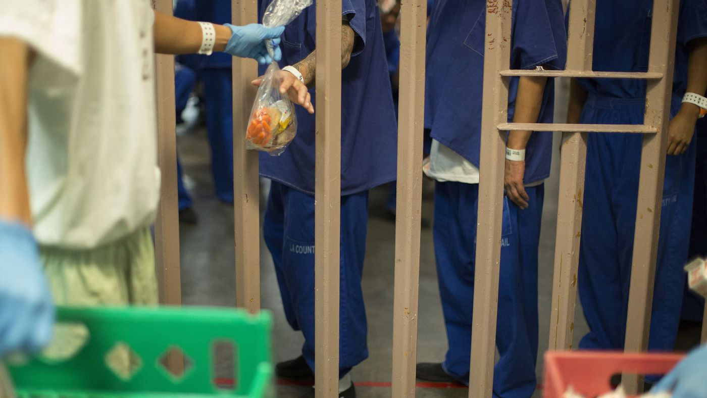 Inmates are seen at the North County Correctional Facility in Castaic in October 2017. A jail guard there was accused of allowing a man to be beaten by other inmates in 2014. (Credit: Myung J. Chun / Los Angeles Times)