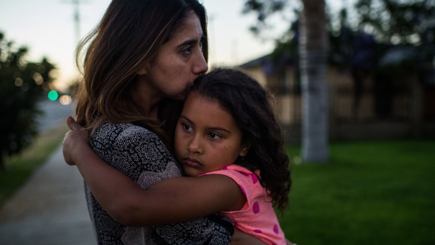More than a week after the arrest of her father Jose Luis Garcia as he watered his lawn, Natalie Garcia tries to console her daughter Marley Hodges outside their home in Arleta. Experts say in the Trump administration's war against illegal immigration, it has lowered the bar for whom immigration agents can go after. (Credit: Gabriel S. Scarlett / Los Angeles Times)