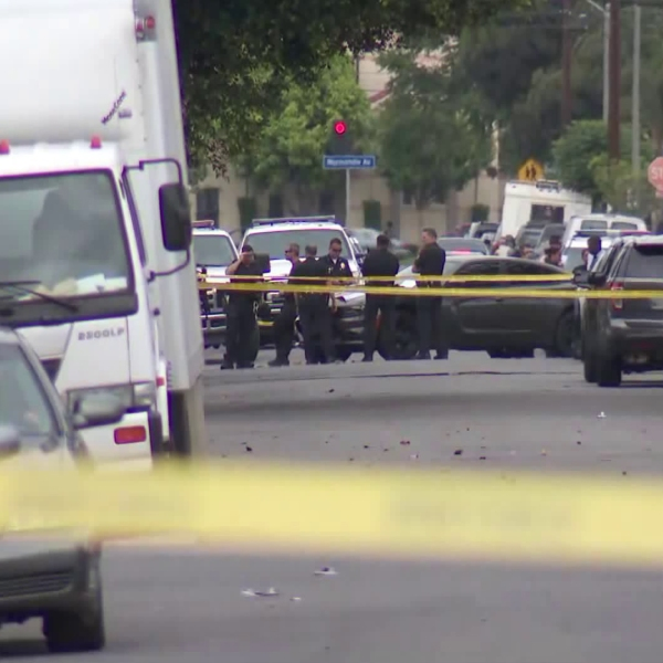 LAPD officers investigate a crash that ended a short pursuit following a road-rage shooting on June 16, 2018. (Credit: KTLA)
