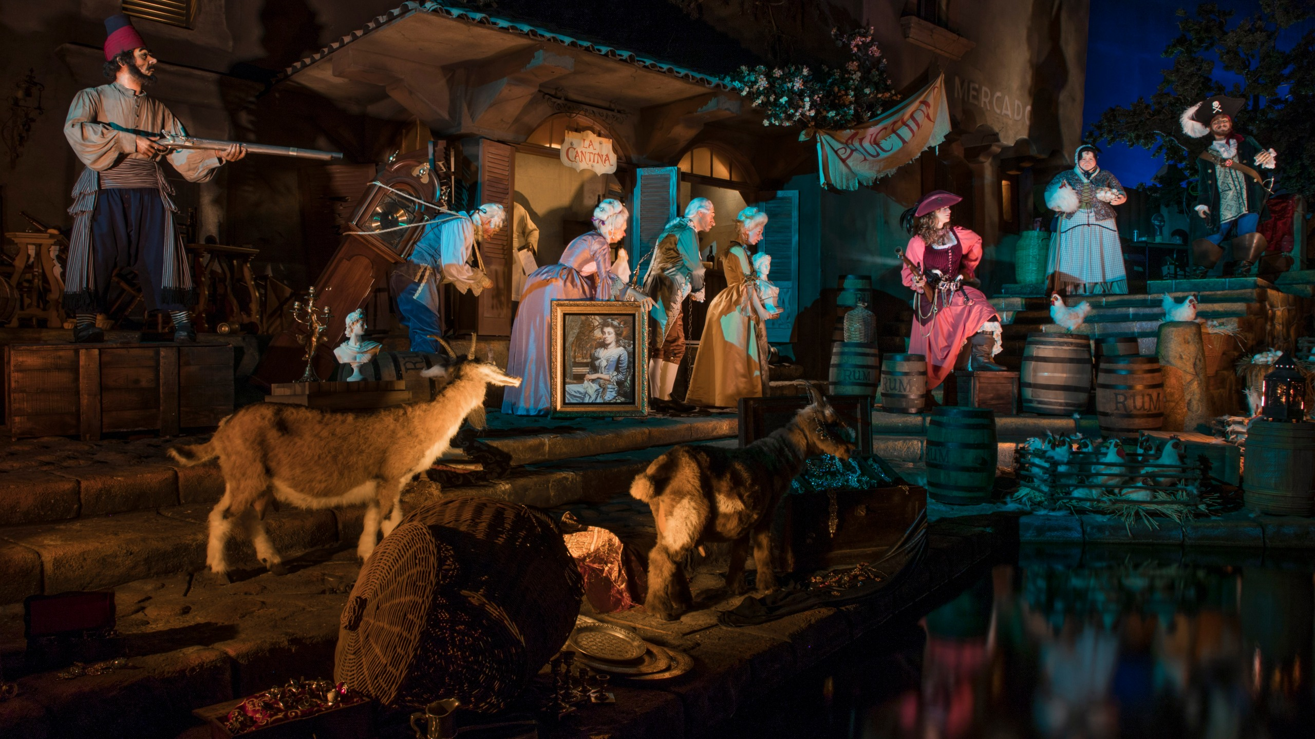 """An image provided by Disney on July 8, 2018 shows a scene from the newly reopened Pirates of the Caribbean ride, which now features a female character named Redd who """"switched sides to become a pirate who's pillaged the town's rum supply. (Credit: Joshua Sudock/Disneyland Resort)"""