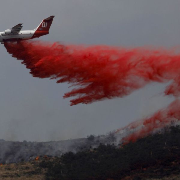 An aircraft drops retardant on the Stone Fire in the Agua Dulce area on June 4, 2018. (Credit: Francine Orr/ Los Angeles Times)