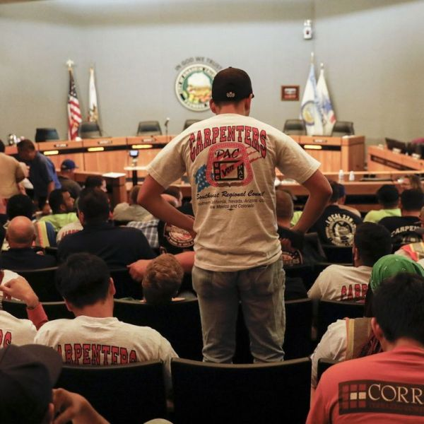 "People wearing union shirts were out in large numbers during the Anaheim City Council meeting on June 19, 2018, as the council decided to put a controversial ""living wage"" measure on the November ballot. (Credit: Jay L. Clendenin / Los Angeles Times)"