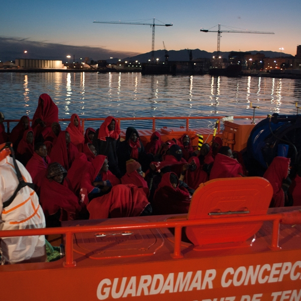 A group of migrants arrive on board a Spanish coast guard vessel at the southern Spanish port of Malaga on Jan. 13, 2018. (Credit: JORGE GUERRERO/AFP/Getty Images)