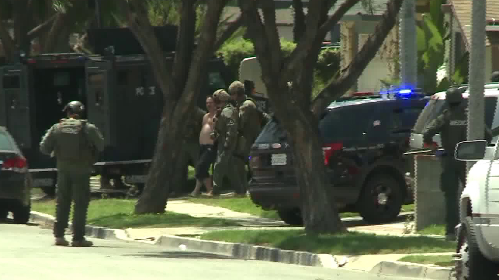 A man is taken into custody following a three-hour standoff with police and SWAT officers in a Brea neighborhood on June 8, 2018. Officers responded after a report of an assault on a 63-year-old woman across the street. (Credit: KTLA)