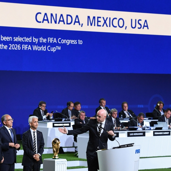 FIFA president Gianni Infantino (R) addresses the United 2026 bid (Canada-Mexico-US) officials following the announcement of the 2026 World Cup host on June 13, 2018. (Credit: KIRILL KUDRYAVTSEV/AFP/Getty Images)