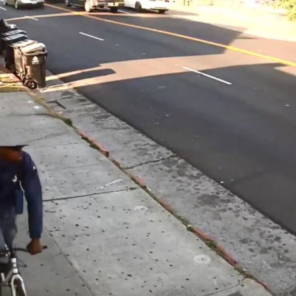 A cyclist described as a person of interest in LAPD's investigation of a killing in South L.A. on May 16, 2018, is seen in this surveillance video released by police on June 6, 2018.